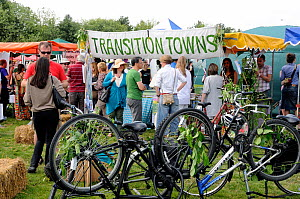 Transition Towns Stall surrounded by people with upsidedown bicycles in front, London Green Fair (previously Camden Green Fair) England UK, June 2011 - Pat  Tuson
