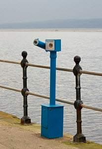 Telescope on West Kirby Promenade overlooking the boating lake. West Kirby, Wirral. Merseyside, England UK. February 2013 - Norma Brazendale