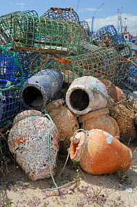 Stack of lobster pots and traditional ceramic Octopus pots encrusted with serpulid worm tubes and barnacles, Culatra island, Parque Natural da Ria Formosa, near Olhao, Algarve, Portugal, June. - Nick Upton