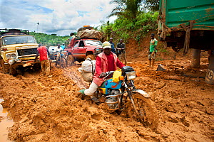 Vehicles stuck in deep mud - the onset of the rainy season deteriorates dirt roads making transport difficult, Cameroon, August 2009. - Jabruson