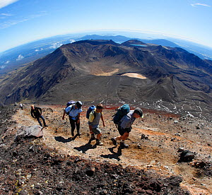 Volcanic scenery along the Tongariro Alpine Crossing. Hikers near the top of Mount. Ngauruhoe ('Mt. Doom' from the 'Lord of the Rings' movies) Mt. Tongariro in background. North Island, New Zealand. M...  -  Brandon Cole