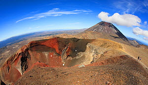 Volcanic scenery along the Tongariro Alpine Crossing, with the Red Crater in foreground, and behind that Mount. Ngauruhoe ('Mt. Doom' from the 'Lord of the Rings' movies.) North Island, New Zealand.  -  Brandon Cole