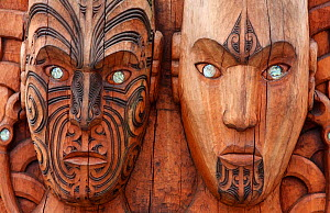 Maori heads wood carving. New Zealand. - Brandon Cole