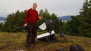 Photographer Niall Benvie talking about the purpose of his portable field studio whilst on assignment for 2020vision, Coigach / Assynt Scottish Wildlife Trust Reserve, Sutherland, Highlands, Scotland,...  -  Raymond  Besant / 2020VISION