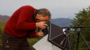 Photographer Niall Benvie using and talking about  his portable field studio set up whilst on assignment for 2020vision, Coigach / Assynt Scottish Wildlife Trust Reserve, Sutherland, Highlands, Scotla...  -  Raymond  Besant / 2020VISION