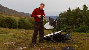 Photographer Niall Benvie setting up his portable field studio whilst on assignment for 2020vision, Coigach / Assynt Scottish Wildlife Trust Reserve, Sutherland, Highlands, Scotland, UK, June 2011. Se...  -  Raymond  Besant / 2020VISION