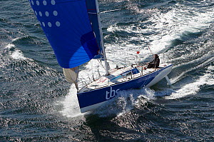 Figaro 'TBS' skippered by Michel Desjoyeaux under spinnaker during training for la Solitaire du Figaro, Port la Foret, France, April 2013. All non-editorial uses must be cleared individually. - Benoit Stichelbaut