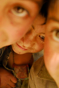 Close up portait of three children, Askole village (3,000m), Braldu Valley, Karakoram Range, Pakistan, July 2007. - Enrique Lopez-Tapia