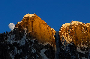 Moon rising from behind mountains, seen from Gore II camp (4,400m), Baltoro Glacier, Central Karakoram National Park, Pakistan, June 2007. - Enrique Lopez-Tapia