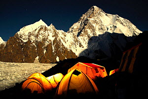 Broad Peak base camp (4,960 m) at night, with K2 (8,611m) and the Godwin-Austen glacier in the background lit by moonlight, Central Karakoram National Park, Pakistan, June 2007. Winner of Photographer... - Enrique Lopez-Tapia,Enrique Lopez-Tapia