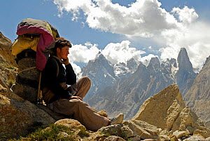 A Balti porter resting, with mountains in the background, Central Karakoram National Park, Pakistan, July 2007. - Enrique Lopez-Tapia