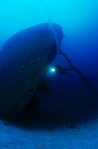 Cargo ship 'Nippo Maru' sunk in Operation Hailstone 17/18th February 1944. Diver on bow of ship. Chuuk Lagoon, Federated States of Micronesia  -  Michael Pitts