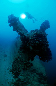 Diver on the propellor of the 'Heian Maru' large cargo vessel sunk at Chuuk Lagoon during Operation Hailstone 17/18th February 1944, Chuuk Lagoon, Federated States of Micronesia  -  Michael Pitts