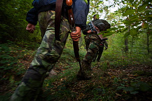 Romanian hunters during a driving hunt for Wild boar (Sus scrofa) in the forest area outside the village of Mehadia, Caras Severin, Romania, October 2012 - Wild Wonders of Europe / Möllers