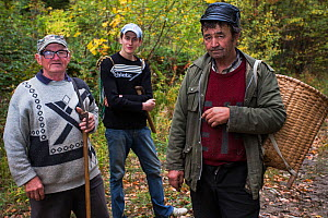 Three Romanian men returning from picking edible tree mushrooms from Common beech forest close to Baile Herculane, Caras Severin, Carpathians, Romania, October 2012  -  Wild Wonders of Europe / Möllers