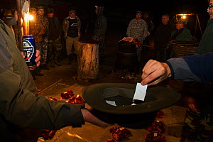 Romanian hunters participating in a lottery to share the freshly prepared meat of a female Wild boar (Sus scrofa) that was shot during a driving hunt. Mehadia, Caras Severin, Romania, October 2012 - Wild Wonders of Europe / Möllers
