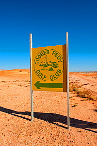 Sign for Coober Pedy golf course - an outback desert, opal mining town, South Australia, June 2010  -  Steven David Miller