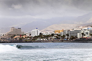 Man surfing, Playa de Las Americas, Tenerife, Canary Islands, Spain, March 2012.  -  Merryn Thomas