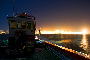 West coast rock lobster (Jasus lalandii) commercial fishing boat (James Archer) leaves the Saldhana Bay harbour before the break of dawn. The lights of the town and the lighthouse flash on the horizon...  -  Cheryl-Samantha  Owen