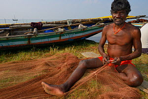 Fisherman mending nets, Pulicat Lake, Tamil Nadu, India, January 2013.  -  Staffan Widstrand