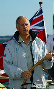 Ted Hood, American yachtsman and naval architect, helming yacht, USA, September 2003.  -  Onne van der Wal