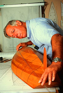 Ted Hood, American yachtsman and naval architect, measuring a hull in his stidio, Portsmouth, Rhode Island, USA.  -  Onne van der Wal