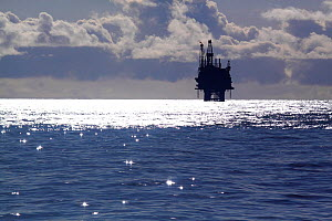 'Tiffany' oil rig platform, in sparkling seas. North Sea, March 2013. All non editorial uses must be cleared individually.  -  Philip Stephen