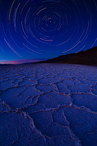 Star trail over Badwater Salt Flats, Death Valley National Park, California. August 2008. Taken with multiple long exposures and fish eye lens.  -  Floris  van Breugel