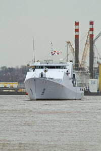 HNLMS Groningen (P843), a Royal Dutch Navy Holland-class Offshore Patrol Vessel, manoeuvres in the River Mersey against the backdrop of Cammell Laird Ship builders , Liverpool, Merseyside, United King... - Graham  Brazendale