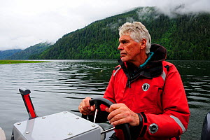 Tom Ellison, founder of the Khutzeymateen Grizzly Bear Sanctuary, at the helm of a boat, British Columbia, Canada, June 2013.  -  Eric Baccega