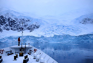 View of Antarctic Peninsula from 'MV Ushuaia' foredeck, with tourist looking out onto the landscape. Antarctica - Enrique Lopez-Tapia,Enrique Lopez-Tapia