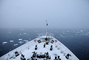 View of Wilhelmina Bay from the snow covered foredeck of an Antarctic cruise liner 'MV Ushuaia' Gerlache Strait. Antarctic Peninsula, Antarctica - Enrique Lopez-Tapia