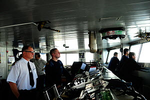 View of control room of Antarctic cruise liner 'MV Ushuaia' with captain and crew looking out of the window, Antarctica  -  Enrique Lopez-Tapia