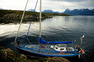 Boat moored in the Beagle Channel (named after visit of the HMS Beagle and Darwin) between Chilean and Argentinian areas of Tierre del Fuego  -  Enrique Lopez-Tapia
