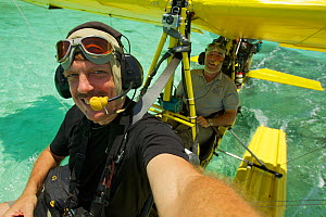 Photographer Tim Laman in the front seat with pilot Max Ammer in ultralight float plane before take off to shoot aerials of the Raja Ampat Islands, West Papua, Indonesia. October 2010  -  Tim Laman