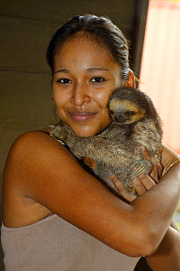 Girl holding young Pale-throated sloth / A� (Bradypus tridactylus) French Guiana. - Daniel  Heuclin
