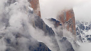 Trango towers in fog, the world's tallest cliffs, Baltoro Glacier, Baltistan, part of the Gilgit-Baltistan territory, northern Pakistan. July 2007.  -  Enrique López-Tapia de Inés