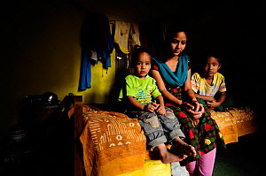 Rabina, widow, in the room that serves as a shelter with her two children, Subin and Sahan, in Namaskar Association �House of Widows�. Culturally in Nepal women lose many rights when they become widow...  -  Enrique López-Tapia