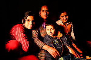 Sita, widow, with her children, Goma, Anish and Aarati,  in the room that serves as a home, in Namaskar Association �House of Widows�. Culturally in Nepal women lose many rights when they become widow...  -  Enrique López-Tapia