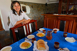 Bed and breakfast hotel owner Betty, standing by dinner table, Wild Farm in Madzharovo valley, Eastern Rhodope Mountains, Bulgaria, May 2013.  -  Wild  Wonders of Europe / Widstr