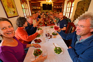 Dinner with the ARK Foundation team in Madzharovo at the Wild Farm, on the right Wouter Helmer, Rewilding Europe and ARK, Eastern Rhodope Mountains, Bulgaria, May 2013.  -  Wild  Wonders of Europe / Widstr