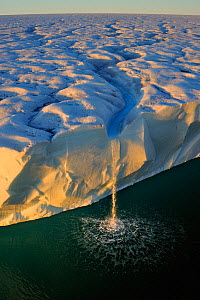 Waterfall from ice cliffs and polar ice cap. Austfonna Polar Ice Cap, Svalbard, Arctic. August 2011. Highly commended in the GDT competition 2013 - Andy Rouse,Andy  Rouse