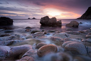Sunset over the Brisons and Porth Nanven, a rocky cove near Land's End, Cornwall, England. April 2012.  -  Adam  Burton