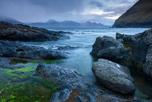 Rocky shores of Gjogv, looking towards the mountains of Kalsoy, Faroe Islands, Europe.  June 2012. - Adam  Burton