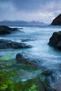 Looking towards the island of Kalsoy from the rocky shores of Gjogv, Eysturoy, Faroes Islands. June 2012. - Adam  Burton