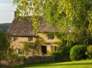 Pretty cottages in the Cotswolds village of Snowshill, Gloucestershire, England. September 2012.  -  Adam  Burton