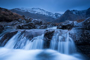 Fairy Pools waterfalls at Glen Brittle, with the snow dusted Cuillin mountains beyond, Isle of Skye, Scotland. November 2012. - Adam  Burton