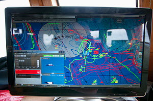 Computer tracking seagoing information aboard commercial fishing trawler. Stellwagen Banks, New England, United States, North Atlantic Ocean  -  Jeff Rotman