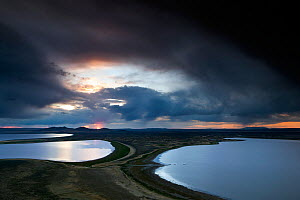 View over the Campbell Lakes with stormy clouds at dusk, viewed from Walker Valley Overlook in Hart Mountain National Antelope Refuge, Oregon, USA, May 2013.  -  Kirkendall-Spring