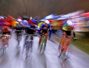 Blurred motion photography of Cyclo-cross cycling race, Washington, USA.  -  Kirkendall-Spring